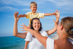 Mother and kids at the beach Stock Photos