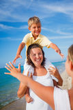 Mother and kids at the beach Stock Photography