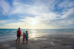 Mother and kids at beach silhouettes Royalty Free Stock Photos