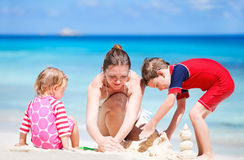 Mother with kids on beach vacation Stock Image
