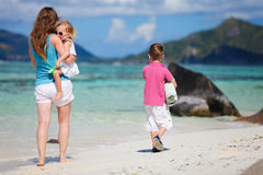 Mother with kids on beach vacation Royalty Free Stock Photo