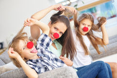 Mother and kids being crazy at home stock images