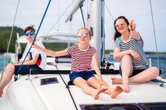 Family on board of sailing yacht. Mother and kids on board of sailing yacht having summer travel adventure royalty free stock photos