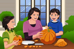 Mother Kids Carving Pumpkins Stock Photography