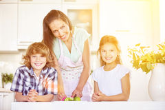 Mother and kids cutting lime fruit royalty free stock photo