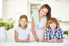 Mother and kids cutting lime fruits Royalty Free Stock Image