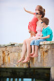Mother and kids enjoying ocean view Stock Photos