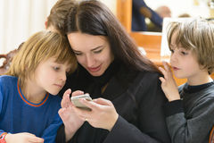 Mother and Kids Enjoying Smartphone Royalty Free Stock Photos
