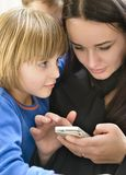 Mother and Kids Enjoying Smartphone Royalty Free Stock Photography