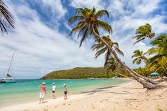 Mother and kids at beach. Mother and kids enjoying tropical beach vacation on Mayreau island in St Vincent and the Grenadines stock photos