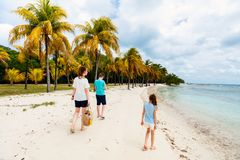 Mother and kids at beach royalty free stock images