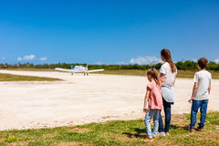 Mother and kids in front of airplane Stock Photography
