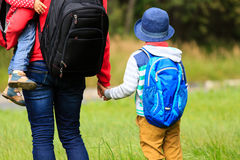Mother with kids going to school or daycare Royalty Free Stock Images