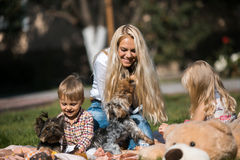 Mother with kids have fun on the grass. (garden royalty free stock photos