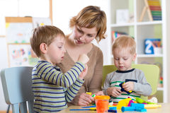 Mother and kids have a fun at home Stock Image