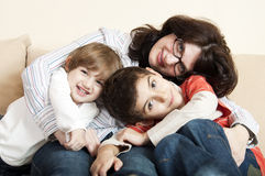 Mother and kids having fun Stock Images