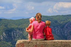 Mother with kids having rest in mountains Royalty Free Stock Photography