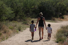 Mother and 2 kids hike Royalty Free Stock Images