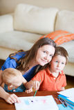 Mother and kids at home Stock Photography