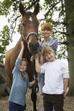 Mother With Kids And Horse Royalty Free Stock Images