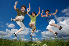 Mother with kids jumping Stock Image