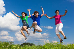 Mother with kids jumping Stock Photography
