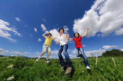 Mother with kids jumping outdoor Royalty Free Stock Image