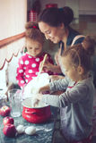 Mother with kids at the kitchen Royalty Free Stock Photos