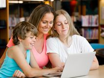 Mother with kids in library Stock Photos