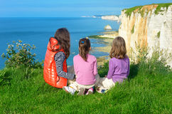 Mother and kids looking at beautiful sea view. Family hiking on vacation in France, Etretat Royalty Free Stock Images