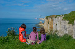 Mother and kids looking at beautiful sea view sitting on rocks, family hiking on vacation in France Stock Photography