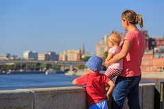 Mother with kids looking at summer city Royalty Free Stock Photo