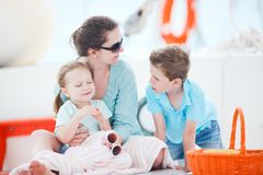 Mother and kids at luxury yacht Stock Photos