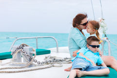 Mother and kids at luxury yacht. Family of mother and her kids having great time sailing at luxury yacht or catamaran boat Royalty Free Stock Photo