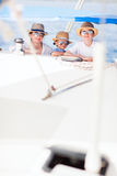 Mother and kids at luxury yacht. Mother and her kids having great time sailing at luxury yacht or catamaran boat Stock Photo