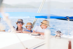 Mother and kids at luxury yacht. Mother and her kids having great time sailing at luxury yacht or catamaran boat Stock Images
