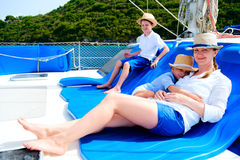 Mother and kids at luxury yacht. Mother and her kids relaxing having great time sailing at luxury yacht or catamaran boat Stock Photos