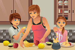 Mother Kids Making Fresh Juice Stock Image