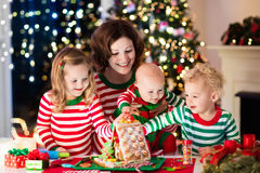 Mother and kids making ginger bread house on Christmas Royalty Free Stock Photos