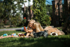 Mother with kids. Mom with daughter on the grass royalty free stock photography