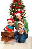 Mother with kids near Christas tree Royalty Free Stock Photo