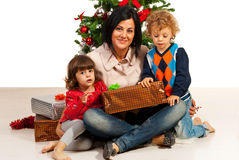 Mother with kids near Xmas tree Stock Image