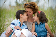 Mother and kids outdoors Stock Images