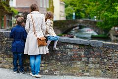 Mother and kids outdoors in Belgium. Mother and her kids outdoors in European city stock photo