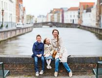 Mother and kids outdoors in Belgium. Mother and her kids outdoors in European city royalty free stock image