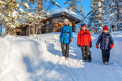 Mother and kids outdoors on winter Stock Photography