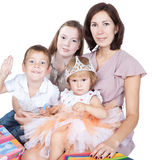 Mother with kids over white Royalty Free Stock Image