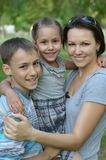 Mother with kids  in park. Happy mother with kids  in a park Stock Photo