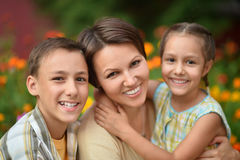 Mother with kids  in park Royalty Free Stock Photo