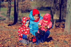 Mother with kids playing in autumn Stock Photography